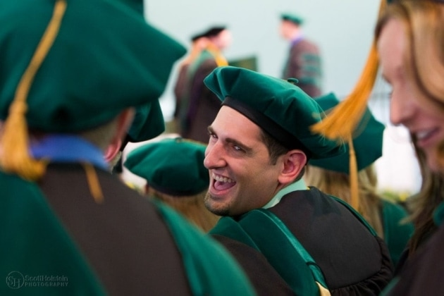 Higher education photography sample: Medical school, featuring a student laughing during his graduation ceremony at WVSOM in West Virginia.