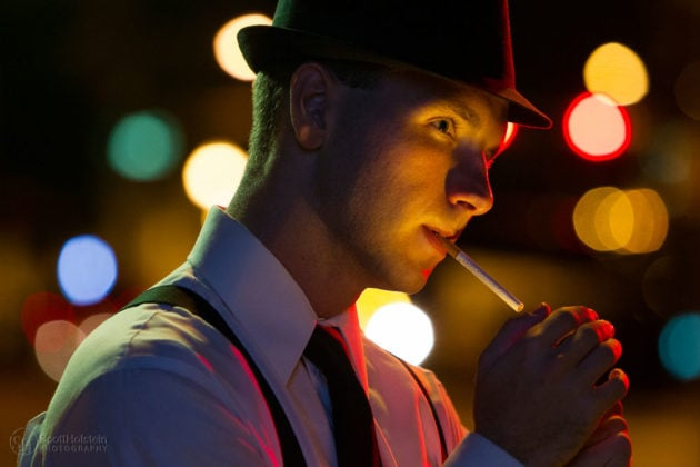 Narrative portrait photography sample featuring a detective in a fedora lighting a cigarette.