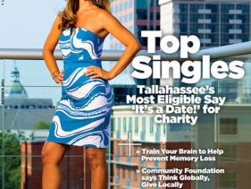 Portrait of a woman in front of the view of downtown by Tallahassee photographer Scott Holstein.
