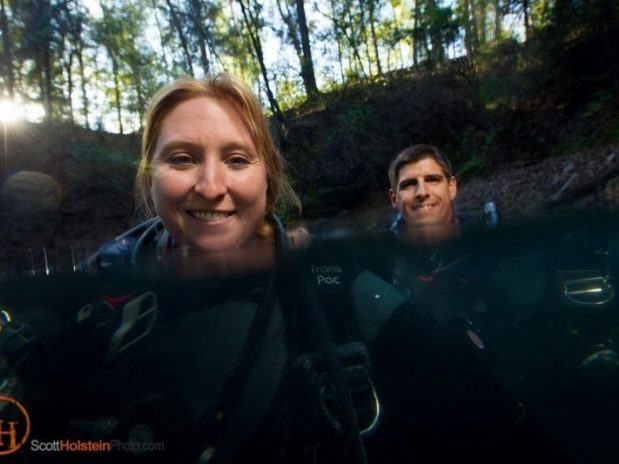 Photo of two cave divers floating in a sinkhole, created using a cheap underwater camera housing.