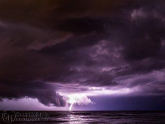 Fine art landscape photography - Lightning strike at night over water.