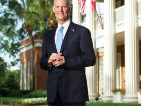 Portrait of Florida Governor Rick Scott in front of the mansion by Tallahassee photographer Scott Holstein.