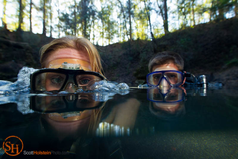 Portrait of cave divers Aletheia and Andre Lange blowing bubbles in Church Sink in Tallahassee.