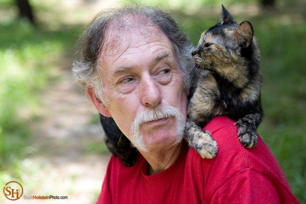 Portrait of Craig Grant with a cat on his shoulders by Florida editorial photographer Scott Holstein.