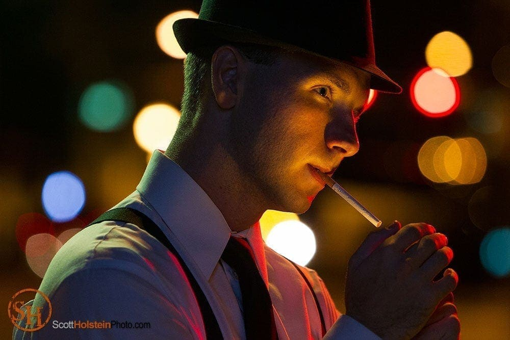 Tallahassee photography of a detective lighting a cigarette at night in a dramatic portrait created by Florida commercial photographer Scott Holstein.
