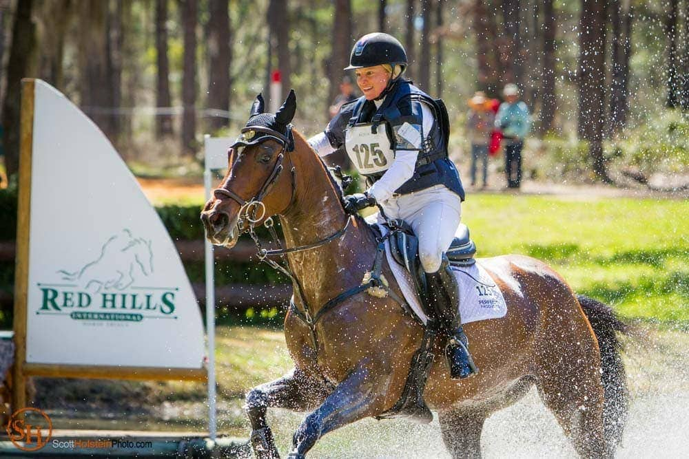 Marilyn Little on RF Quarterman splash through a water feature during x-country at Red Hills Horse Trials.
